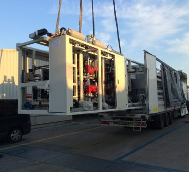 Unloading and placing a wrapping machine